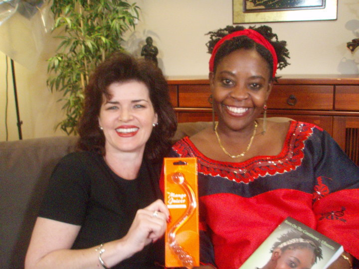 Samantha Bachman & Getrude Matshe talking the Mango Juicer
